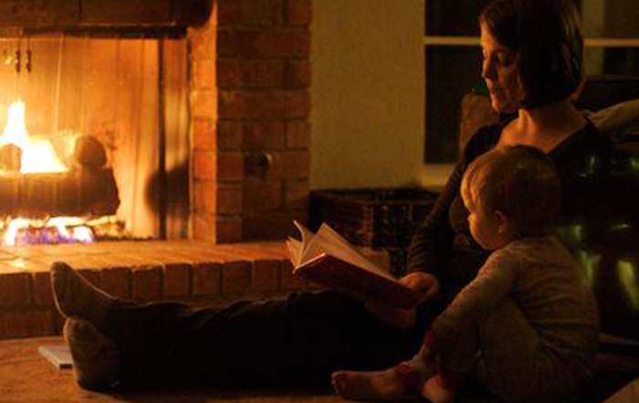 mom and child by fireplace